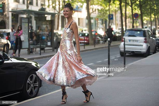 Giovanna Battaglia wears a pink Valentino couture dress after the Valentino show at Htel Salomon de Rothschild on July 6 2016 in Paris France