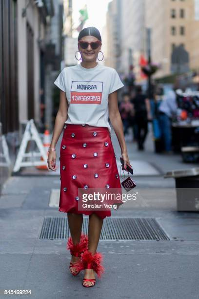 Giovanna Engelbert wearing a red skirt white tshirt with print red heels seen in the streets of Manhattan outside Victoria Beckham during New York...