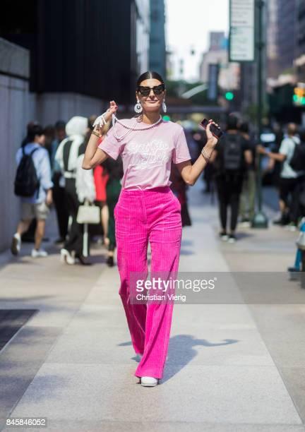 Giovanna Engelbert wearing pink velvet pants seen in the streets of Manhattan outside Derek Lam during New York Fashion Week on September 11 2017 in...