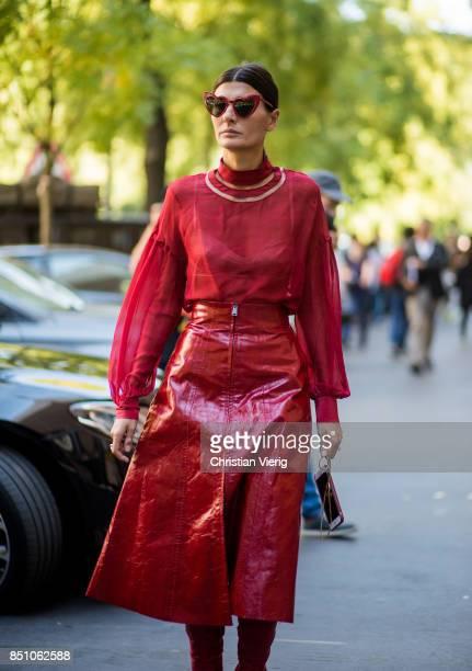Giovanna Engelbert wearing red blouse red skirt red overknees is seen outside Fendi during Milan Fashion Week Spring/Summer 2018 on September 21 2017...