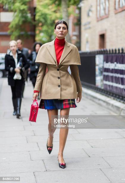 Giovanna Engelbert wearing red turtleneck beige jacket outside Anya Hindmarch during London Fashion Week September 2017 on September 17 2017 in...