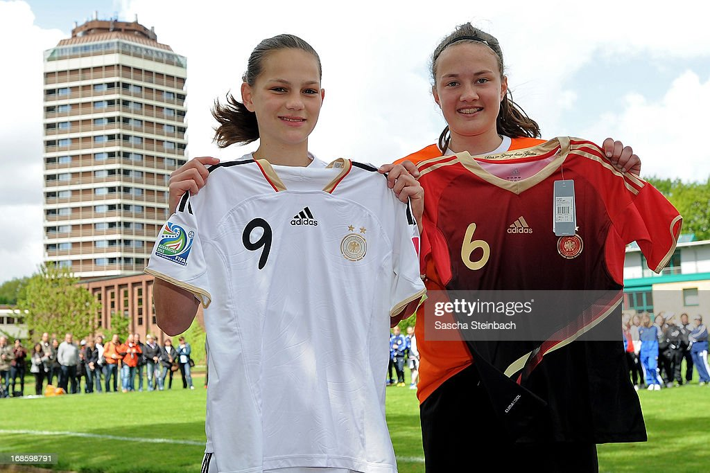 Giovanna Hoffmann (L) of team Bremen and Steffi Sanders (R) of team Niedersachsen pose for best scorers during the U15 Federal Cup of the German Football Association DFB at Sports Academy Wedau on May 12, 2013 in Duisburg, Germany.