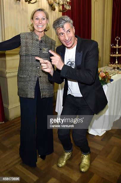 Giovanna Melandri and artist Maurizio Cattelan attends 'SHIT AND DIE' Vernissage at palazzo Cavour on November 5 2014 in Turin Italy