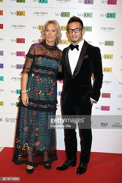 Giovanna Melandri President of Fondazione MAXXI and Hidetoshi Nakata attend a photocall for the MAXXI Acquisition Gala Dinner 2016 at Maxxi Museum on...