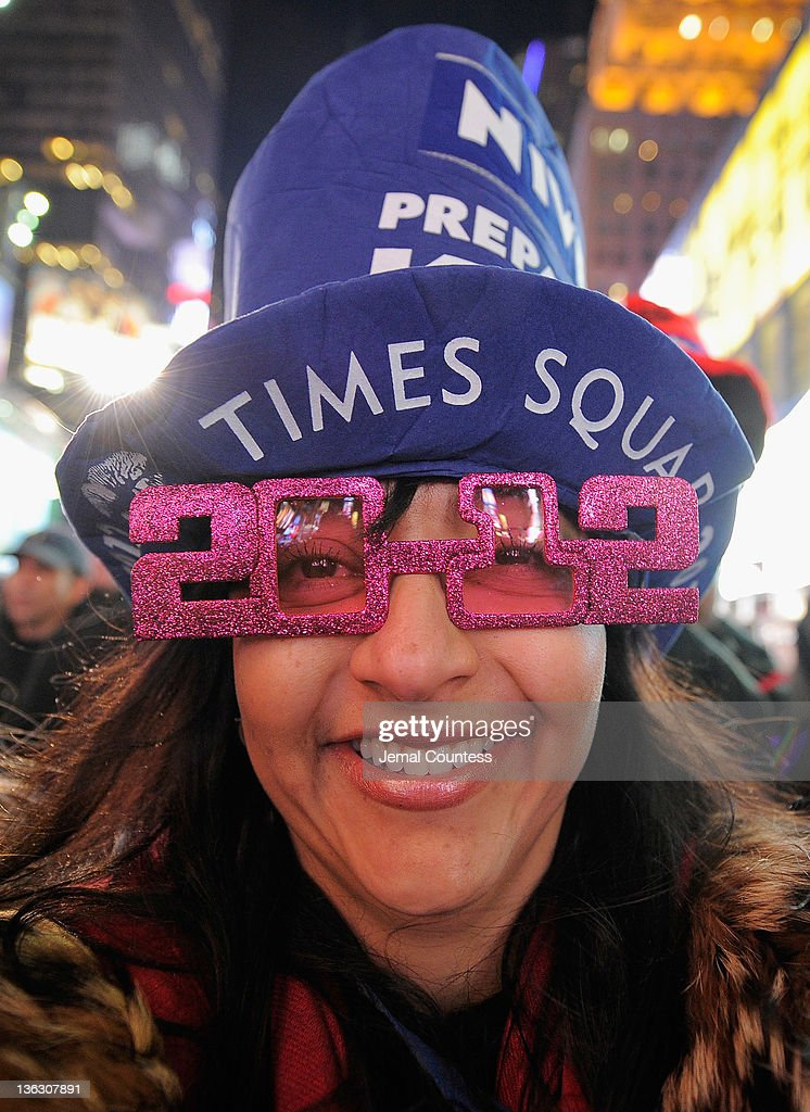 Giovanna Rodger joins thousands of revelers gathered in New York's Times Square to celebrate the ball drop at the annual New Years Eve celebration on December 31, 2011 in New York City.