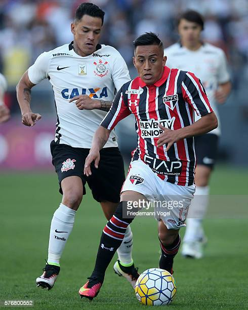 Giovanni Augusto of Corinthians fights for the ball with Cueva of Sao Paulo during the match between Corinthians and Sao Paulo for the Brazilian...