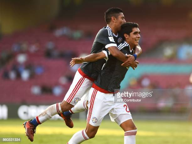 Giovanni Bogado of Paraguay celebrates with Antonio Galeano after scoring a goal during the group stage football match between Turkey and Paraguay in...