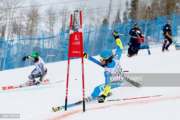 Giovanni Borsotti of Italy loses his balance against Phil Brown of Canada during the Nations Team Event at Golden Peak Stadium on Day 9 of the 2015...