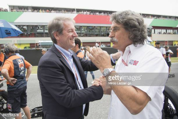 Giovanni Copioli of Italy and President of FMI greets Paolo Simoncelli of Italy on the grid the Moto3 race during the MotoGp of Italy Race at Mugello...