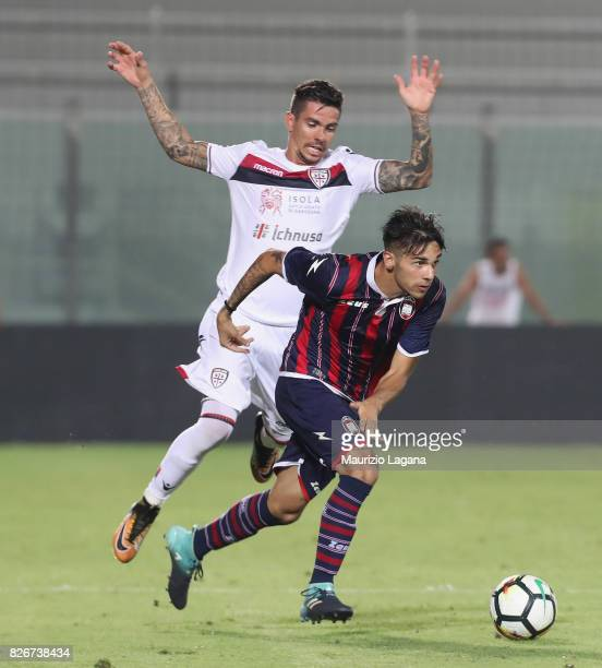 Giovanni Crociata of Crotone competes for the ball with Diego Farias of Cagliari during the PreSeason Friendly match between FC Crotone and Cagliari...