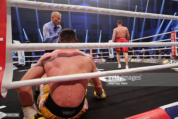 Giovanni De Carolis of Italy is knocked out by Tyron Zeuge of Germany during their WBA Super Middleweight World Championship title fight at MBS Arena...