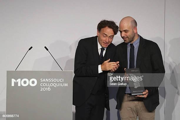 Giovanni di Lorenzo editorinchief at Die Zeit and investigative journalist and writer Roberto Saviano chat after di Lorenzo awarded Saviano the M100...