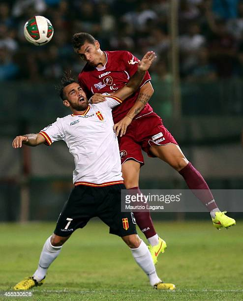 Giovanni Di Lorenzo of Reggina competes for the ball with Luca Orlando of Messina during the Lega Pro match between Reggina Calcio and ACR Messina at...