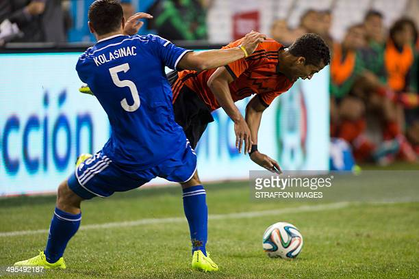 Giovanni dos Santos of Mexico is tackled by Sead Kolasinac of BosniaHerzegovina during the Internatinal friendly match between Mexico and...