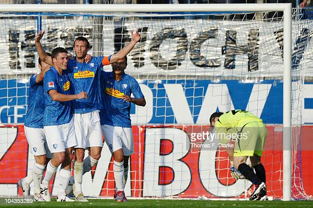 Giovanni Federico Christoph Dabrowski and Chong Tese of Bochum celebrate their teams second goal while Dennis Eilhoff of Bielefeld looks dejected...