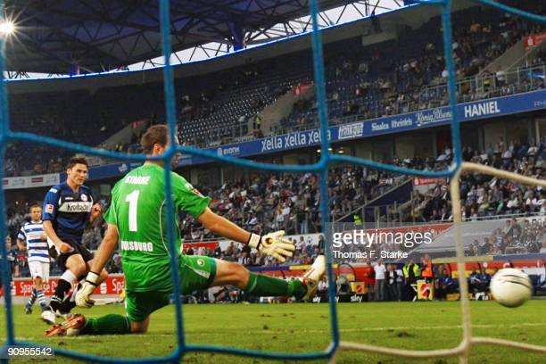 Giovanni Federico of Bielefeld scores his team's third goal against goalkeeper Tom Starke during the Second Bundesliga match between MSV Duisburg and...