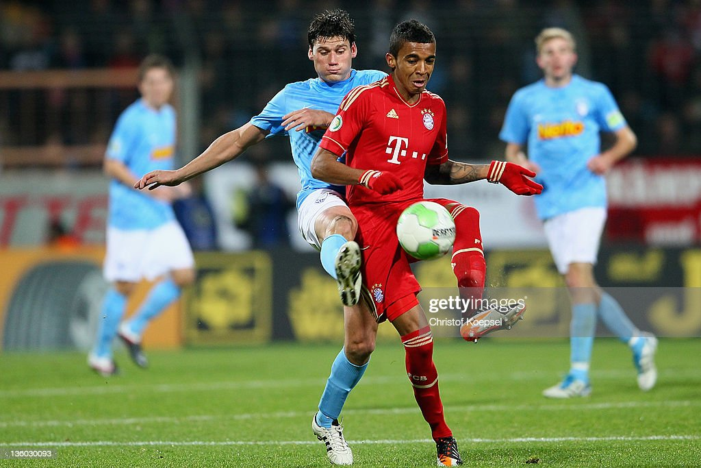 Giovanni Frederico of Bochum challenges Luiz Gustavo of Bayern during the DFB Cup round of sixteen match between VfL Bochum and FC Bayern Muenchen at...