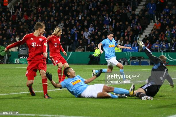 Giovanni Frederico of Bochum scores the first goal against Manuel Neuer of Muenchen during the DFB Cup round of sixteen match between VfL Bochum and...