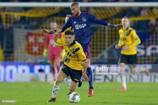 Giovanni Korte of NAC Breda Hakim Ziyech of Ajax during the Dutch Eredivisie match between NAC Breda v Ajax at the Rat Verlegh Stadium on November 18...