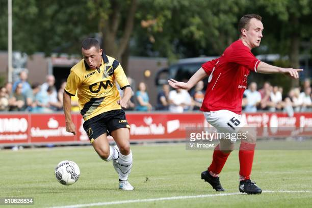 Giovanni Korte of NAC Breda Melvin van Dalen of Madese Boys during the friendly match between Madese Boys and NAC Breda at Sportpark De Schietberg on...