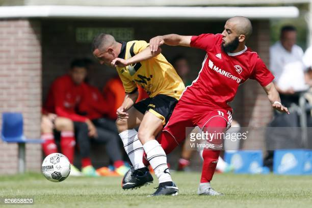 Giovanni Korte of NAC Breda Soufyane Ahannach of Almere City during the friendly match between NAC Breda and Almere City FC at Sportpark...