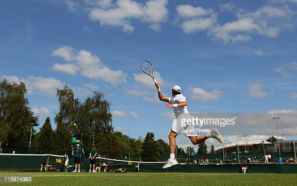 Giovanni Lapentti of Ecuador plays a forehand in his match against Jurgen Zopp of Estonia during day one of the Wimbledon Championships 2011...