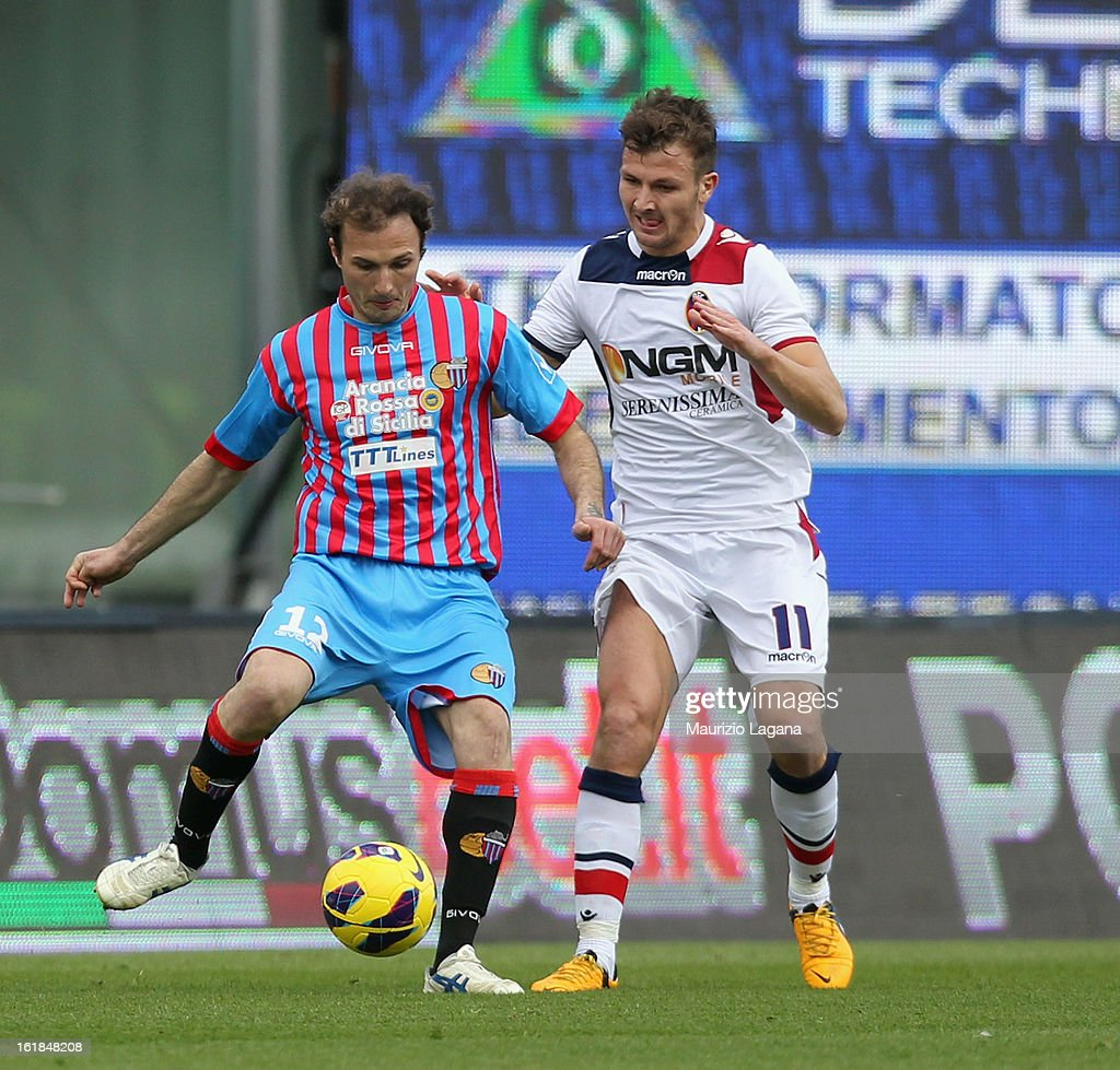 Giovanni Marchese (L) of Catania competes for the ball with Marco Motta of Bologna during the Serie A match between Calcio Catania and Bologna FC at Stadio Angelo Massimino on February 17, 2013 in Catania, Italy.