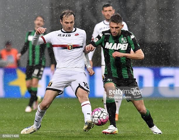 Giovanni Marchese of Genoa CFC and Domenico Berardi of US Sassuolo Calcio in action during the Serie A match between US Sassuolo Calcio and Genoa CFC...