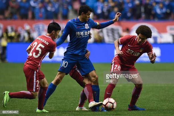 Giovanni Moreno of Shanghai Shenhua and Axel Witsel of Tianjin Quanjian compete for the ball during the 2nd round match of CSL Chinese Football...