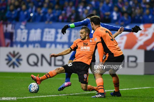 Giovanni Moreno of Shanghai Shenhua and Jack Hingert of Brisbane Roar compete for the ball during the AFC Champions League 2017 playoff match between...