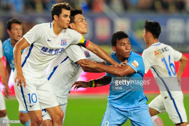 Giovanni Moreno of Shanghai Shenhua and Roger Martnez of Jiangsu Suning compete for the ball during the 16th round match of 2017 Chinese Football...