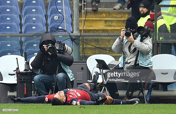 Giovanni Pablo Simeone of Genoa celebrates his goal lying on the pitch in front of photographers during the Serie A match between Genoa CFC and FC...