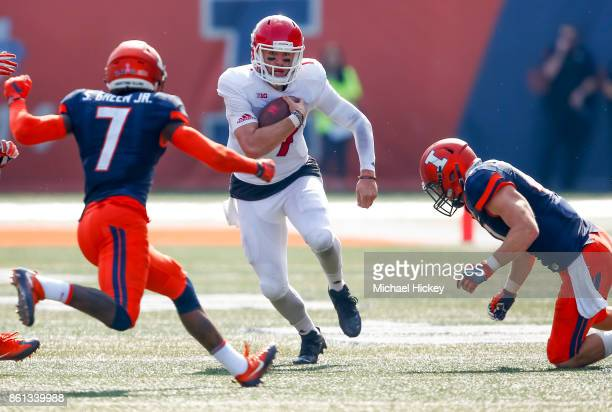 Giovanni Rescigno of the Rutgers Scarlet Knights runs the ball as Stanley Green of the Illinois Fighting Illini approaches for the tackle at Memorial...