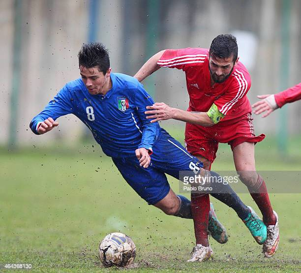 Giovanni Sbrissa of Italy competes for the ball with Ilia Kerdzevadze of Georgia during the international friendly match between Italy U19 and...