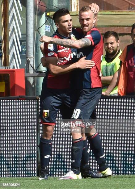 Giovanni Simeone and Luca Rigoni of Genoa celebrate after the 20 goal during the Serie A match between Genoa CFC and FC Torino at Stadio Luigi...