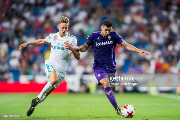 Giovanni Simeone of ACF Fiorentina competes for the ball with Marcos Llorente of Real Madrid during the Santiago Bernabeu Trophy 2017 match between...