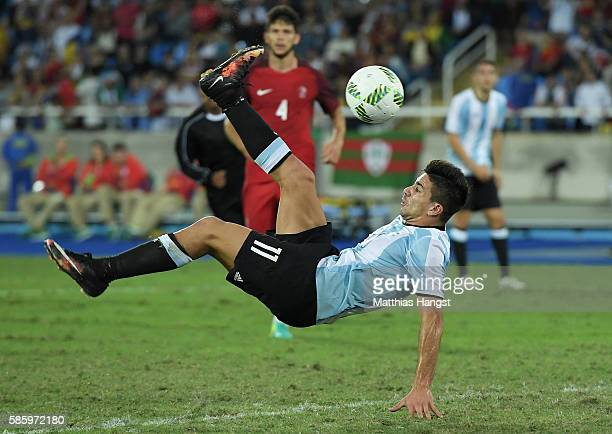 Giovanni Simeone of Argentina shoots during the Men's Group D first round match between Portugal and Argentina during the Rio 2016 Olympic Games at...