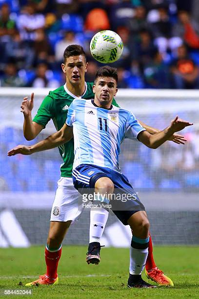 Giovanni Simeone of Argentina struggles for the ball with Cesar Montes of Mexico during an U23 International Friendly between Mexico and Argentina at...