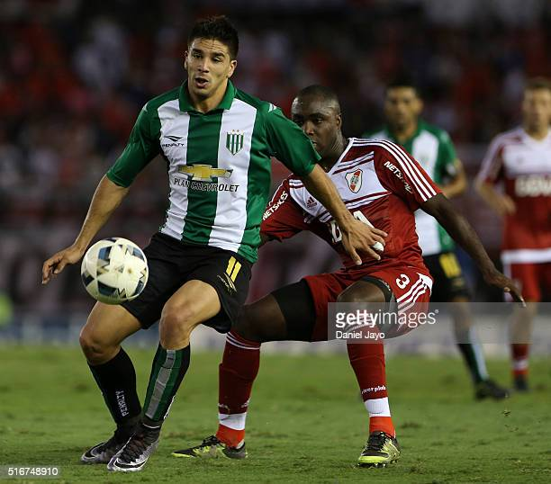 Giovanni Simeone of Banfield and Eder Balanta of River Plate battle for the ball during a match between River Plate and Banfield as part of round 8...