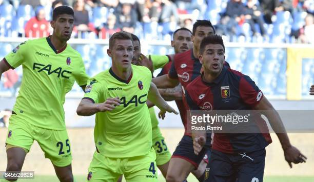 Giovanni Simeone of Genoa Adam Masina and Emil Krafth of Bologna in action during the Serie A match between Genoa CFC and Bologna FC at Stadio Luigi...