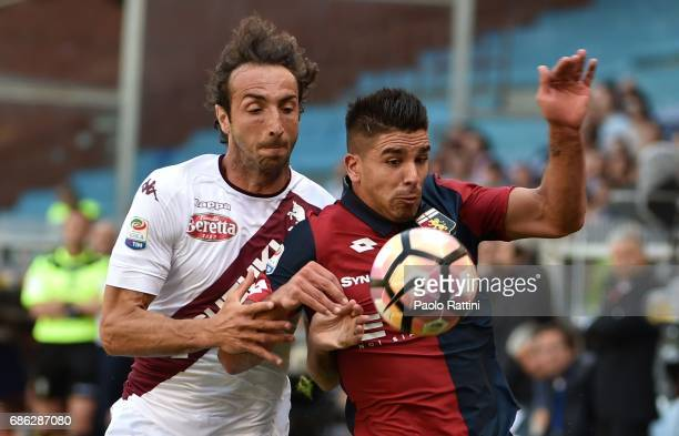Giovanni Simeone of Genoa and Emiliano Moretti of Torino during the Serie A match between Genoa CFC and FC Torino at Stadio Luigi Ferraris on May 21...