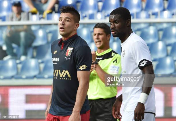 Giovanni Simeone of Genoa and Isaac Donkor of Cesena during the TIM Cup match between Genoa CFC and AC Cesena at Stadio Luigi Ferraris on August 13...