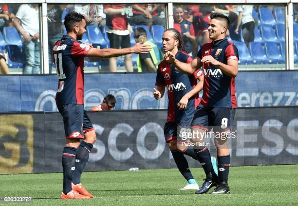 Giovanni Simeone of Genoa CFC celebrates with teammates after scoring a goal 20 during the Serie A match between Genoa CFC and FC Torino at Stadio...