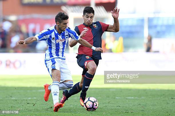 Giovanni Simeone of Genoa CFC competes with Gaston Brugman of Pescara Calcio during the Serie A match between Genoa CFC and Pescara Calcio at Stadio...
