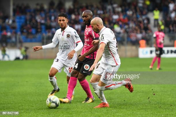 Giovanni Sio of Montpellier and Hicham Mahou and Christophe Jallet of Nice during the Ligue 1 match between Montpellier Herault SC and OGC Nice at...