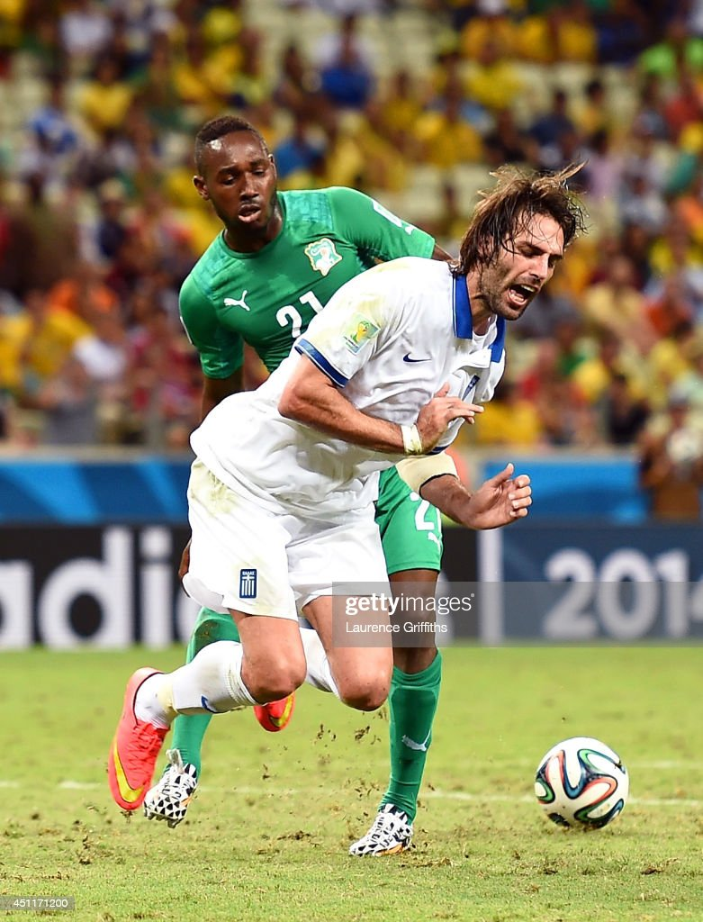 <a gi-track='captionPersonalityLinkClicked' href=/galleries/search?phrase=Giovanni+Sio&family=editorial&specificpeople=7023343 ng-click='$event.stopPropagation()'>Giovanni Sio</a> of the Ivory Coast fouls Giorgos Samaras of Greece resulting in a penalty kick during the 2014 FIFA World Cup Brazil Group C match between Greece and the Ivory Coast at Castelao on June 24, 2014 in Fortaleza, Brazil.