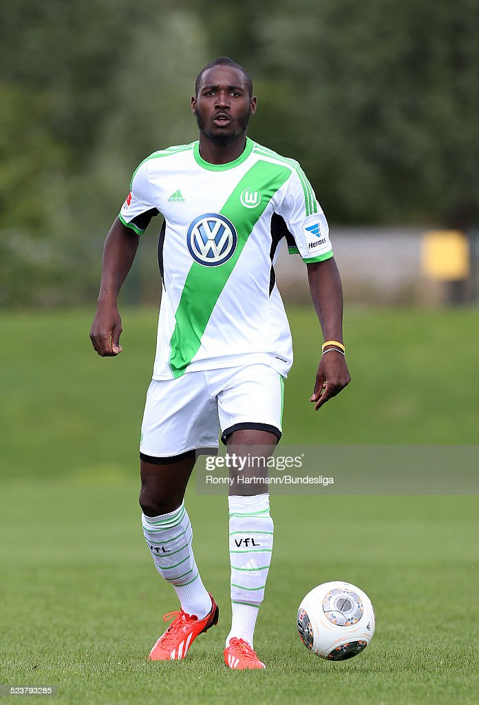 <a gi-track='captionPersonalityLinkClicked' href=/galleries/search?phrase=Giovanni+Sio&family=editorial&specificpeople=7023343 ng-click='$event.stopPropagation()'>Giovanni Sio</a> of Wolfsburg in action during the VfL Wolfsburg Media Day for DFL at the training ground of the team on July 18, 2013 in Wolfsburg, Germany.
