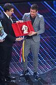 Giovanni Toti and italian singer Francesco Gabbani winner of Nuove Proposte category of the 66th Italian Music Festival in Sanremo poses with his...