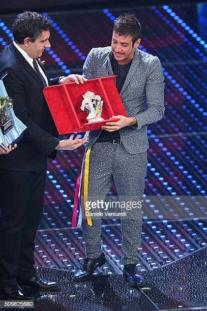 Giovanni Toti and italian singer Francesco Gabbani winner of Nuove Proposte category of the 66th Italian Music Festival in Sanremo poses with his...