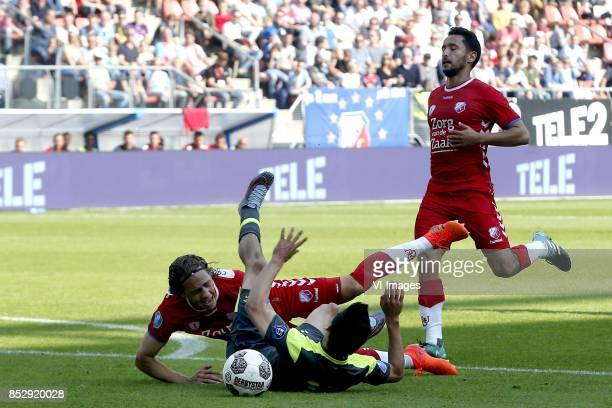 Giovanni Troupee of FC Utrecht Hirving Lozano of PSV during the Dutch Eredivisie match between FC Utrecht and PSV Eindhoven at the Galgenwaard...
